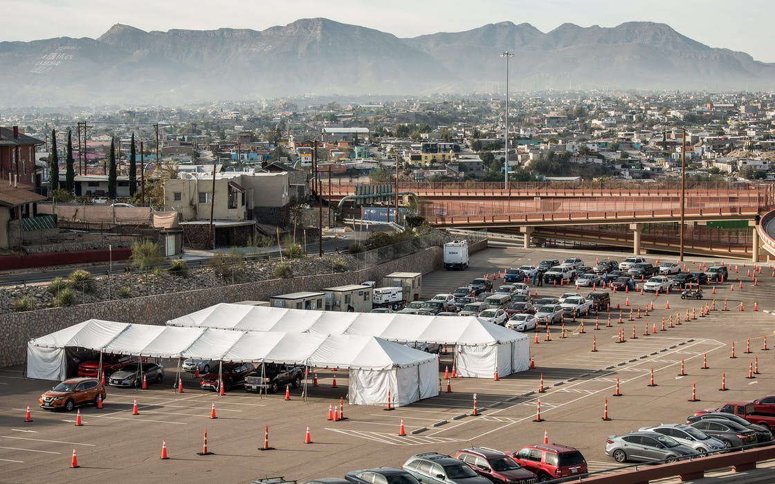 Cars pass through a coronavirus testing site at the University of Texas El Paso on October 31, 2020 in El Paso.