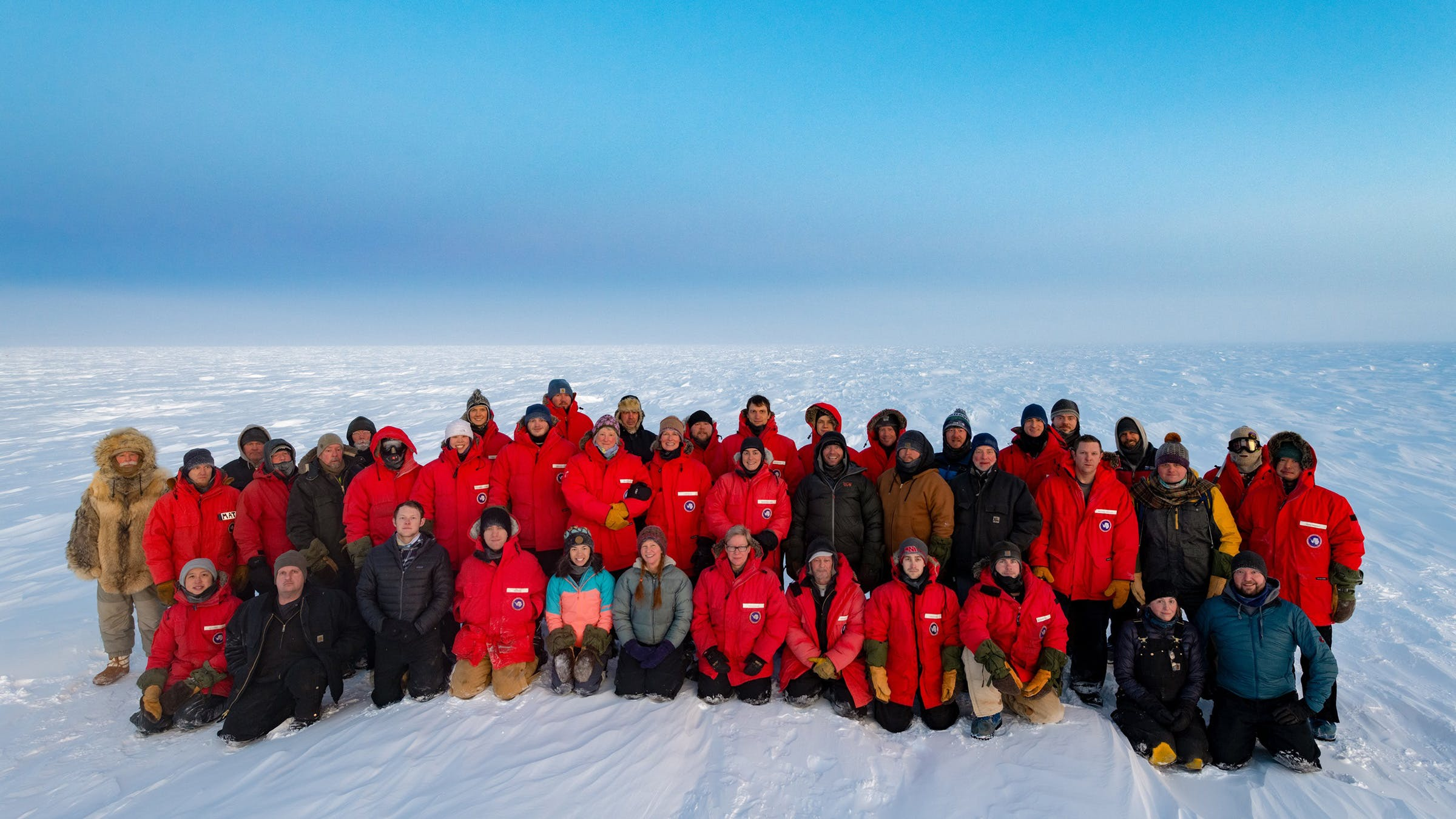 White (far left) dons his wolf furs in the official photo of the South Pole 2020 winter crew from September 2020. This photo will hang on the wall at the South Pole research station as long as the US has a presence there.