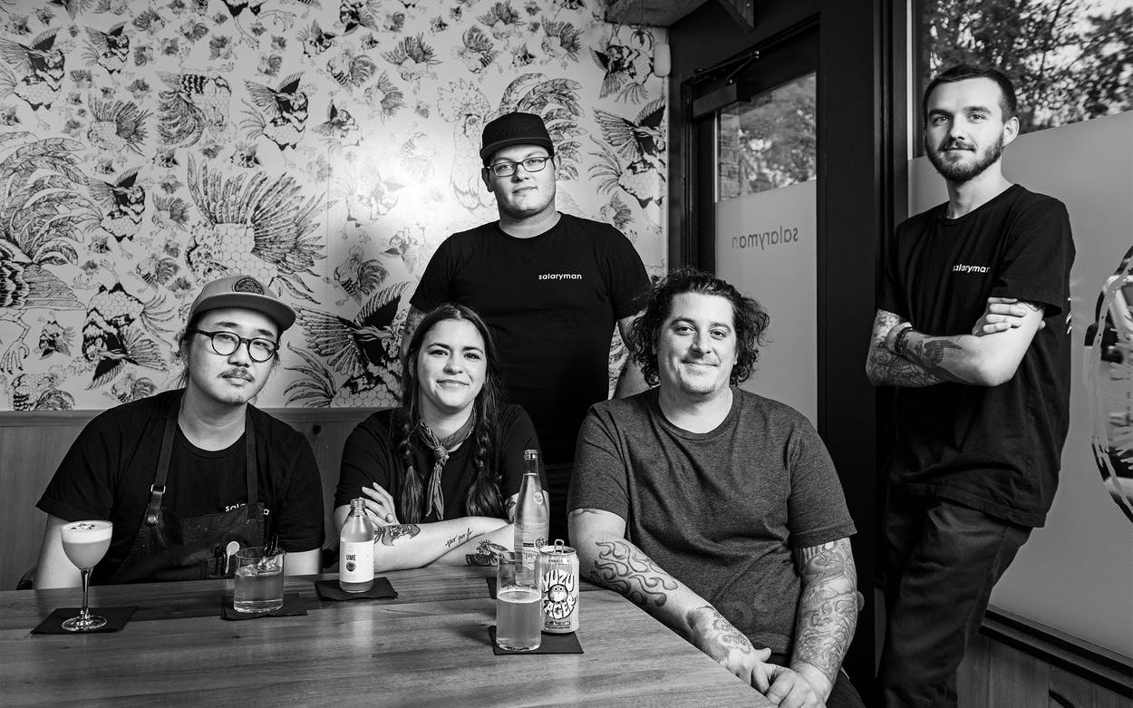 Chef Justin Holt (fourth from left) and his staff at Salaryman, in Dallas, in October 2019.