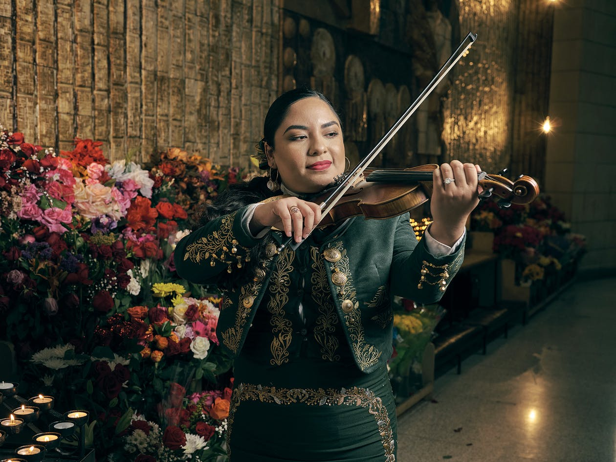 Cecilia Chavez plays her violin at the Basilica of Our Lady of San Juan del Valle in San Juan on October 18, 2020.