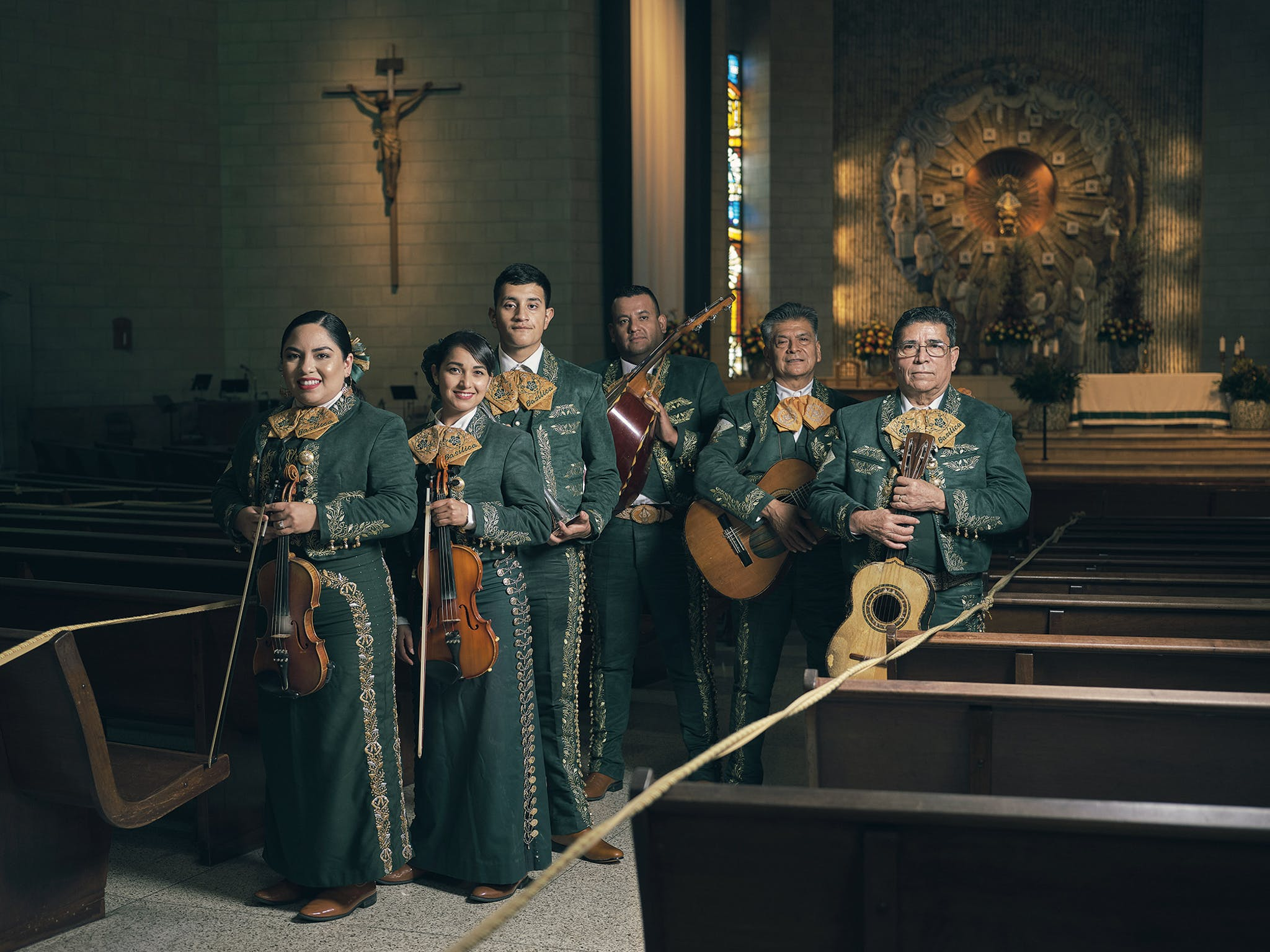 Mariachi choir members Cecilia Chavez, Ana Tirado, Victor Fortuna, Genero Fortuna, Francisco Morales, and Arturo Hernandez with their instruments at the Basilica of Our Lady of San Juan del Valle in San Juan on October 18, 2020.