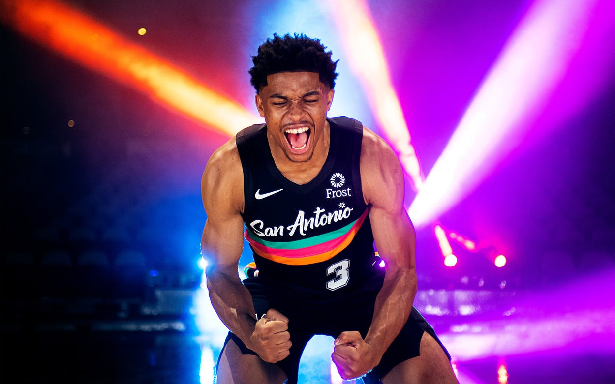 San Antonio Spurs guard Keldon Johnson poses for a photo on the floor during the shoot for the Fiesta jersey and court reveal for the 2020 - 2021 season at the AT&T Center in San Antonio, on November 4, 2020.