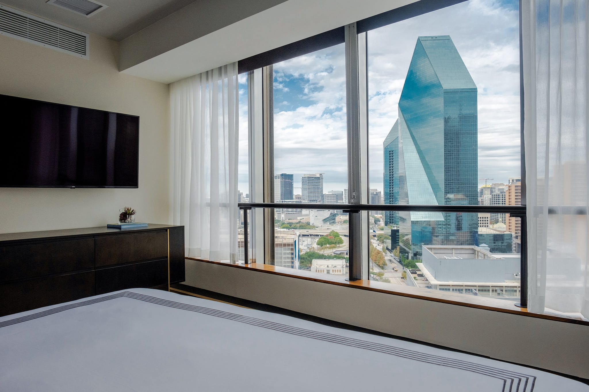 In most guest rooms, the beds also face views of downtown Dallas (a TV is discreetly situated off to the side). The hotel is a short stroll away from the Adolphus hotel, which also underwent a recent renovation, and the Dahl-designed Neiman Marcus flagship.