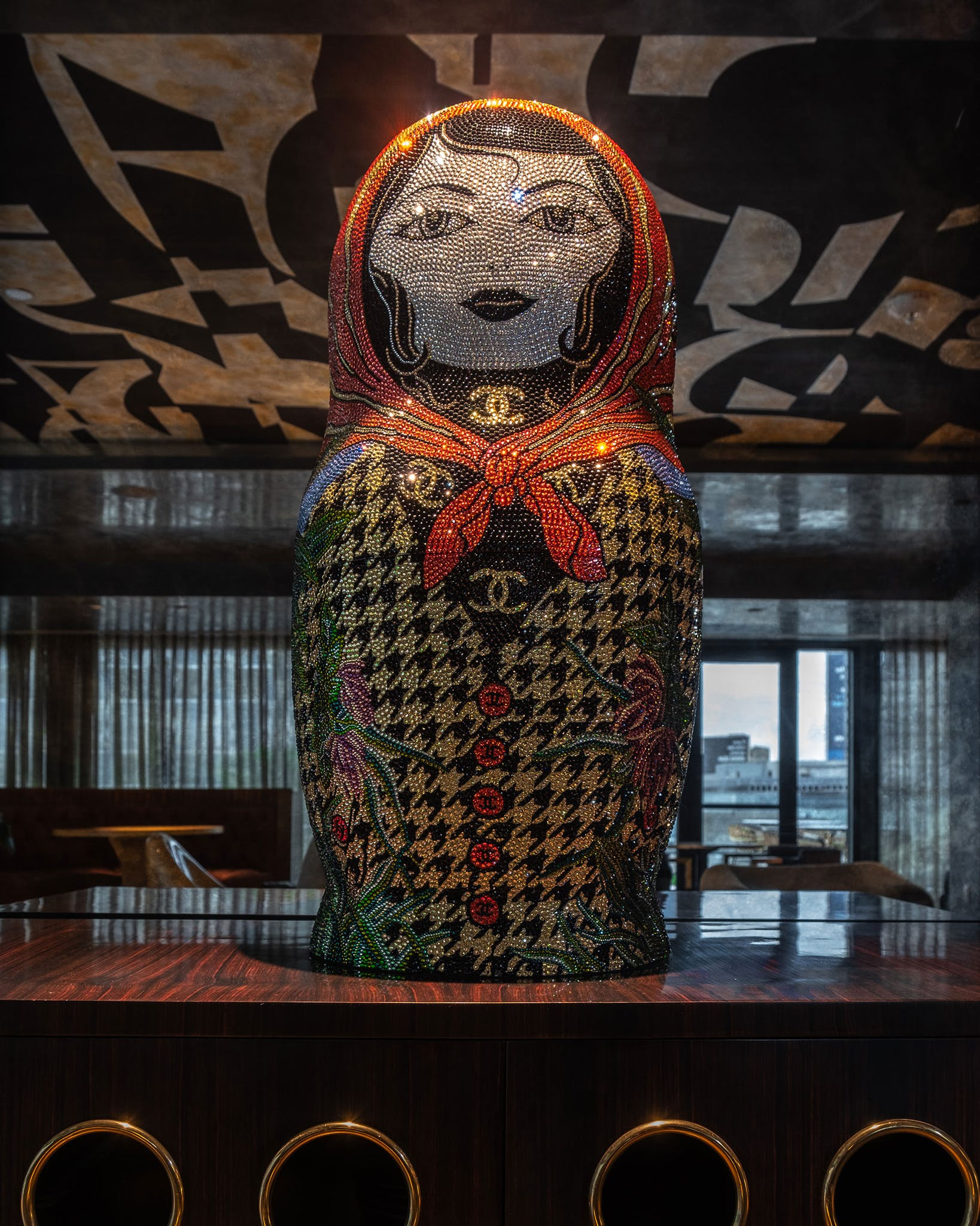 """As is the case throughout the hotel, Catbird features art in many forms. The Chanel motifs on this Swarovski-crystal-covered sculpture by Metis Atash speak to the """"ladies who lunch"""" set, who would also feel at home at the nearby Nine at the National restaurant, which opened at the hotel this week. (There, Caroline installed shimmering banquettes and tweed-backed chairs that nod to Gabrielle """"Coco"""" Chanel herself.)"""