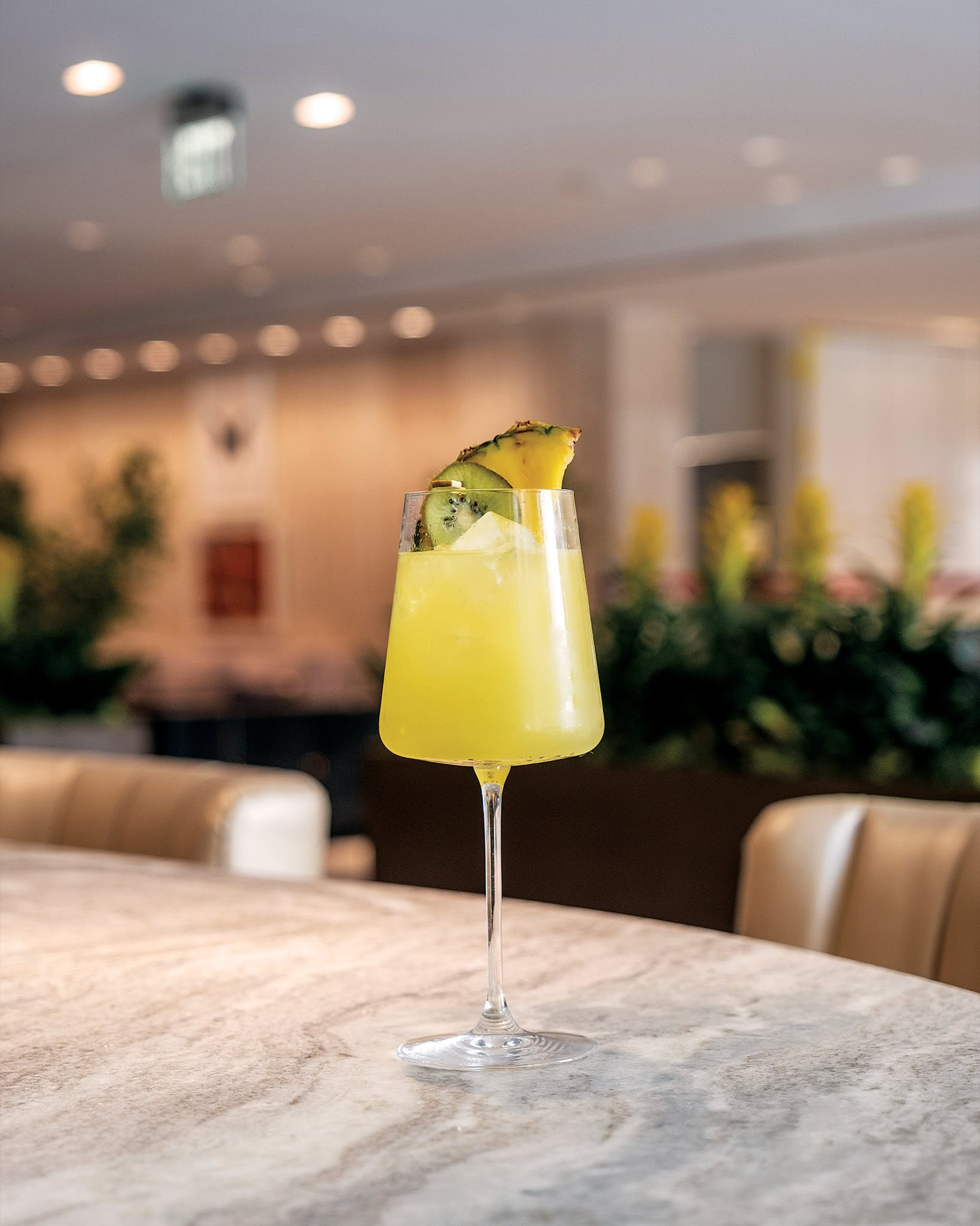 The Nine at the National restaurant opened this week with a menu that caters to professionals, including grab-and-go offerings and libations like this one—a kiwi and pineapple twist on the classic gin and tonic called Hello Sunshine.
