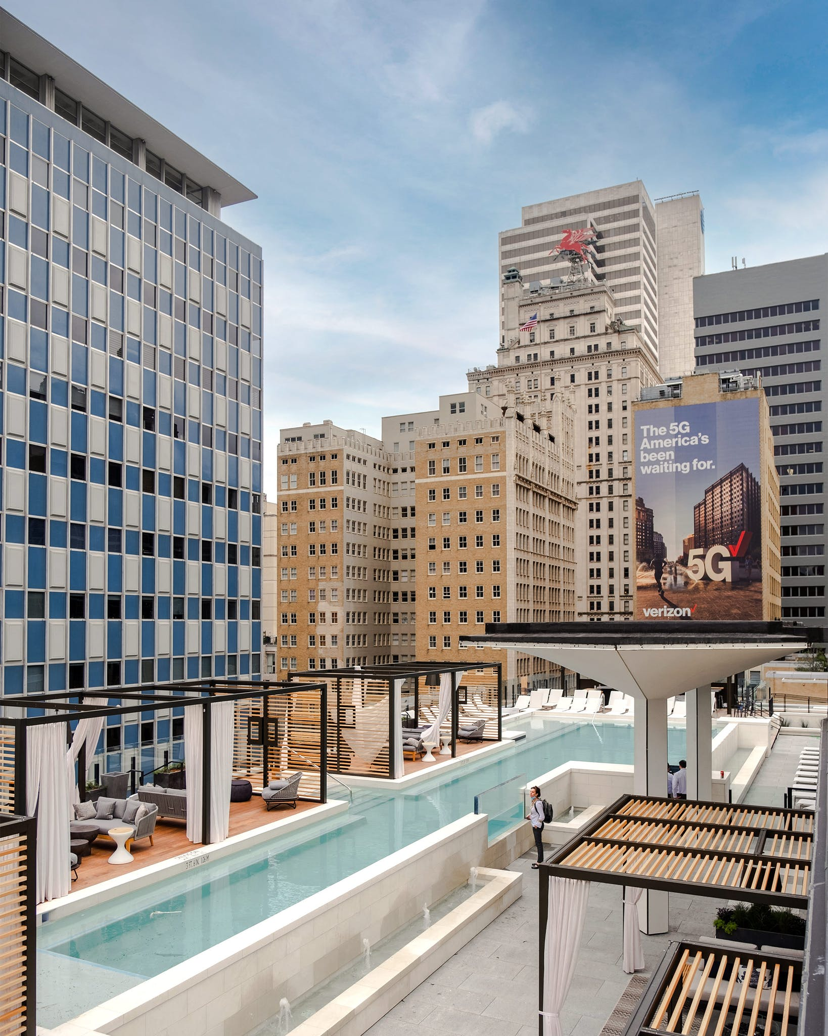 The ninth-floor pool is an urban oasis complete with private Cabo-esque cabanas. The tall, decorative, mushroom-shaped structures on the right are original to the historic building.