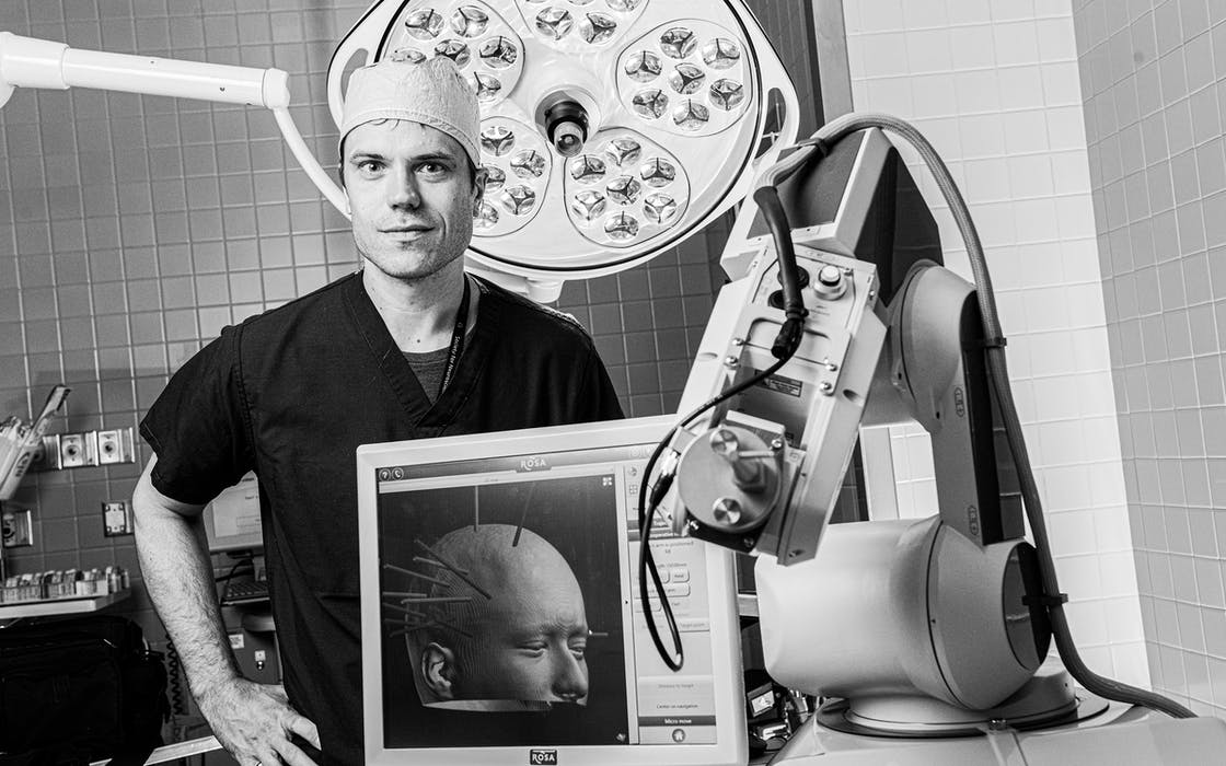 Dr. Bradley Lega, a UT Southwestern neurosurgeon who treats epilepsy and brain tumors, studies his patients' brain waves associated with memory processing.