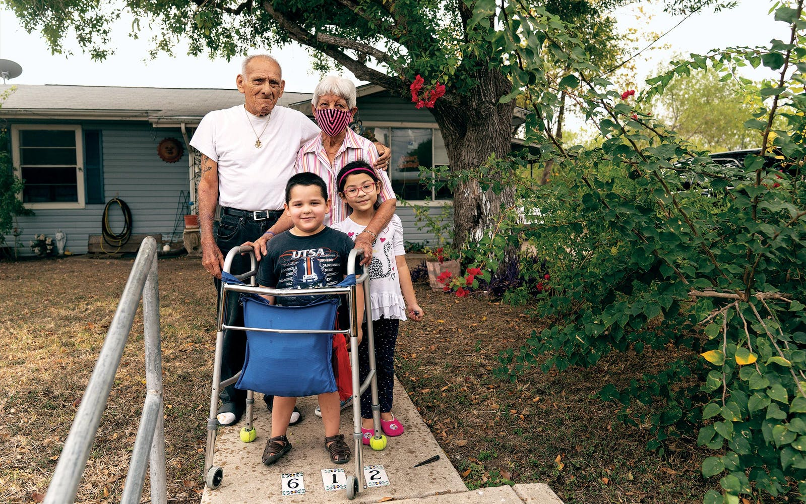 Roberto and Maria Garcia pose for a portrait with their great-grandchildren Jason, 4, and Emerald, 6.