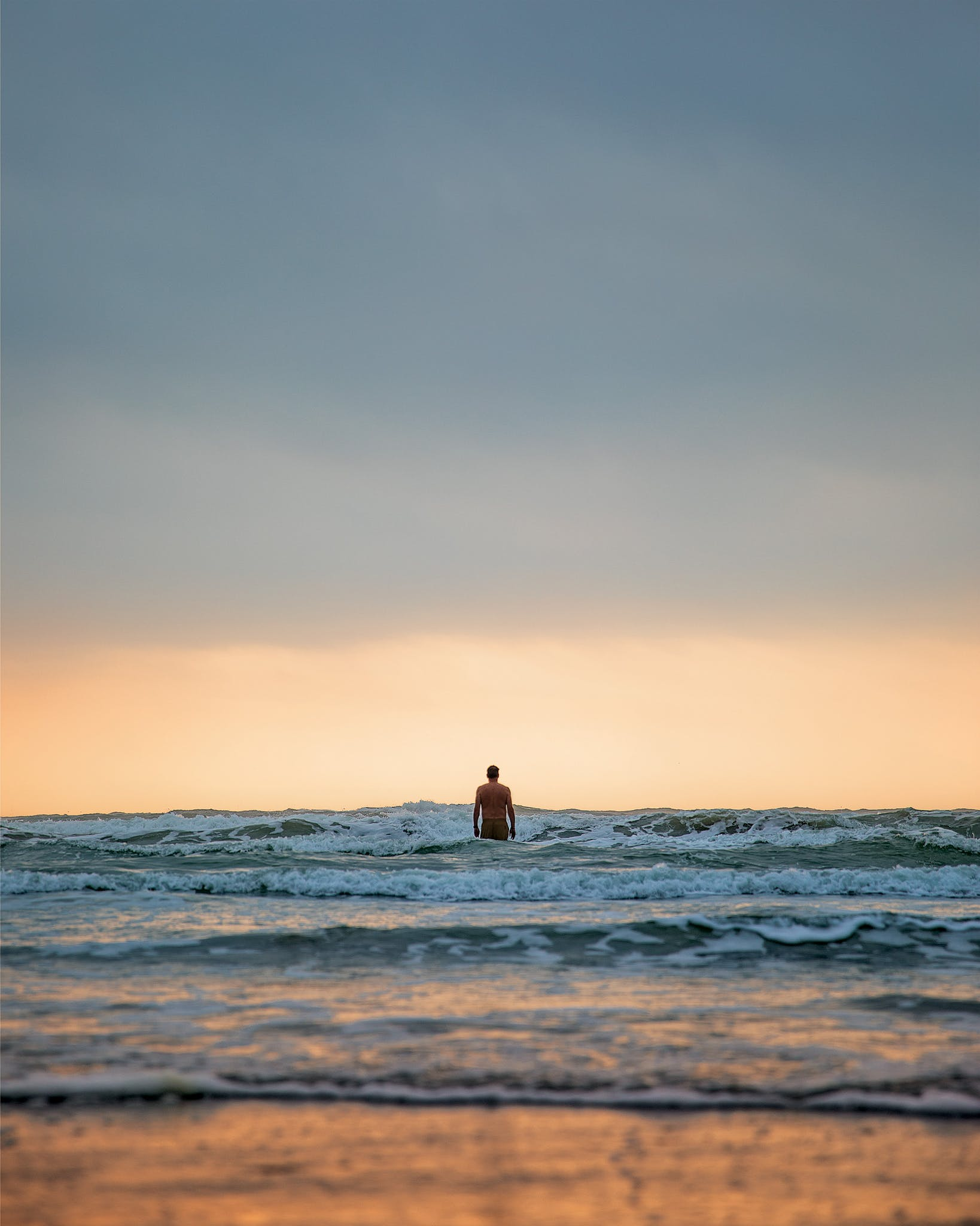 Writer David Courtney takes an early morning dip around mile marker 20 on Padre Island National Seashore on March 24, 2020.