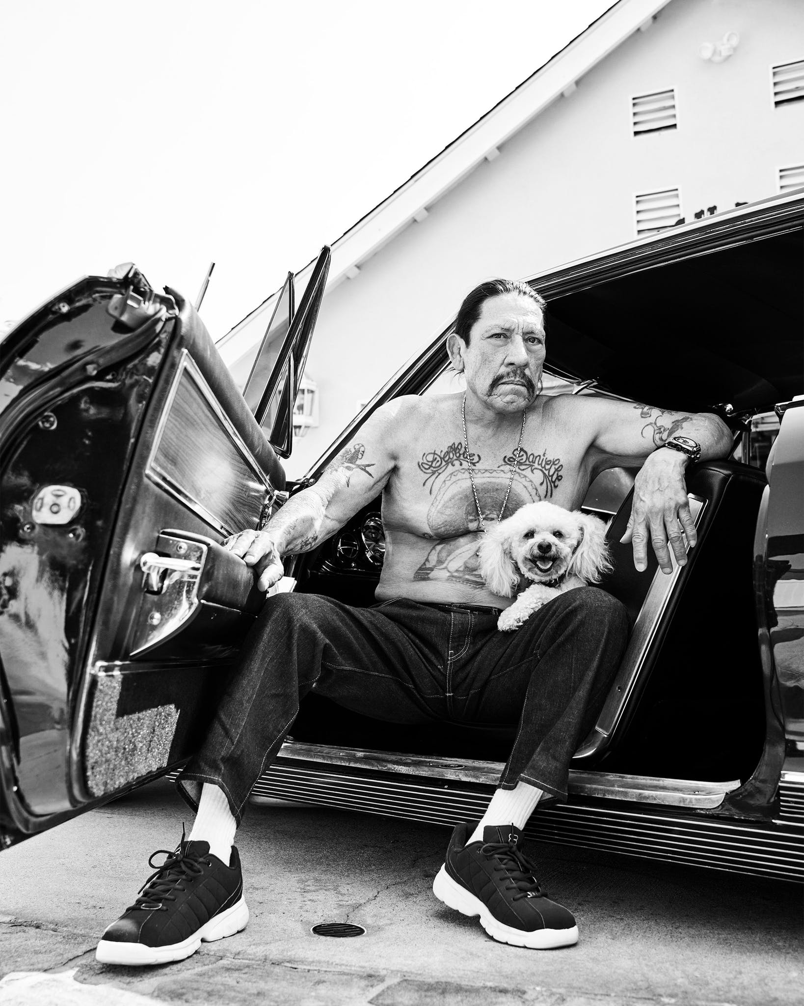 Danny Trejo and one of his dogs, Zelda, outside his home in Mission Hills, California.
