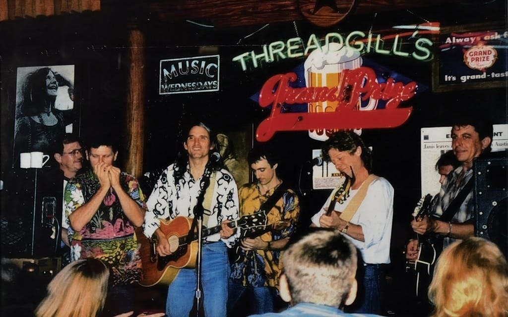 Butch Hancock, Jimmie Dale Gilmore, Rich Brotherton, Champ Hood, and Joe Ely playing at Threadgill's in the 1980s.