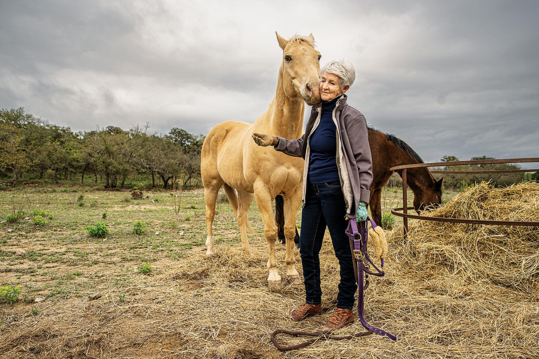 Paulette Jiles with her horses at her home, in Utopia, on March 20, 2020.