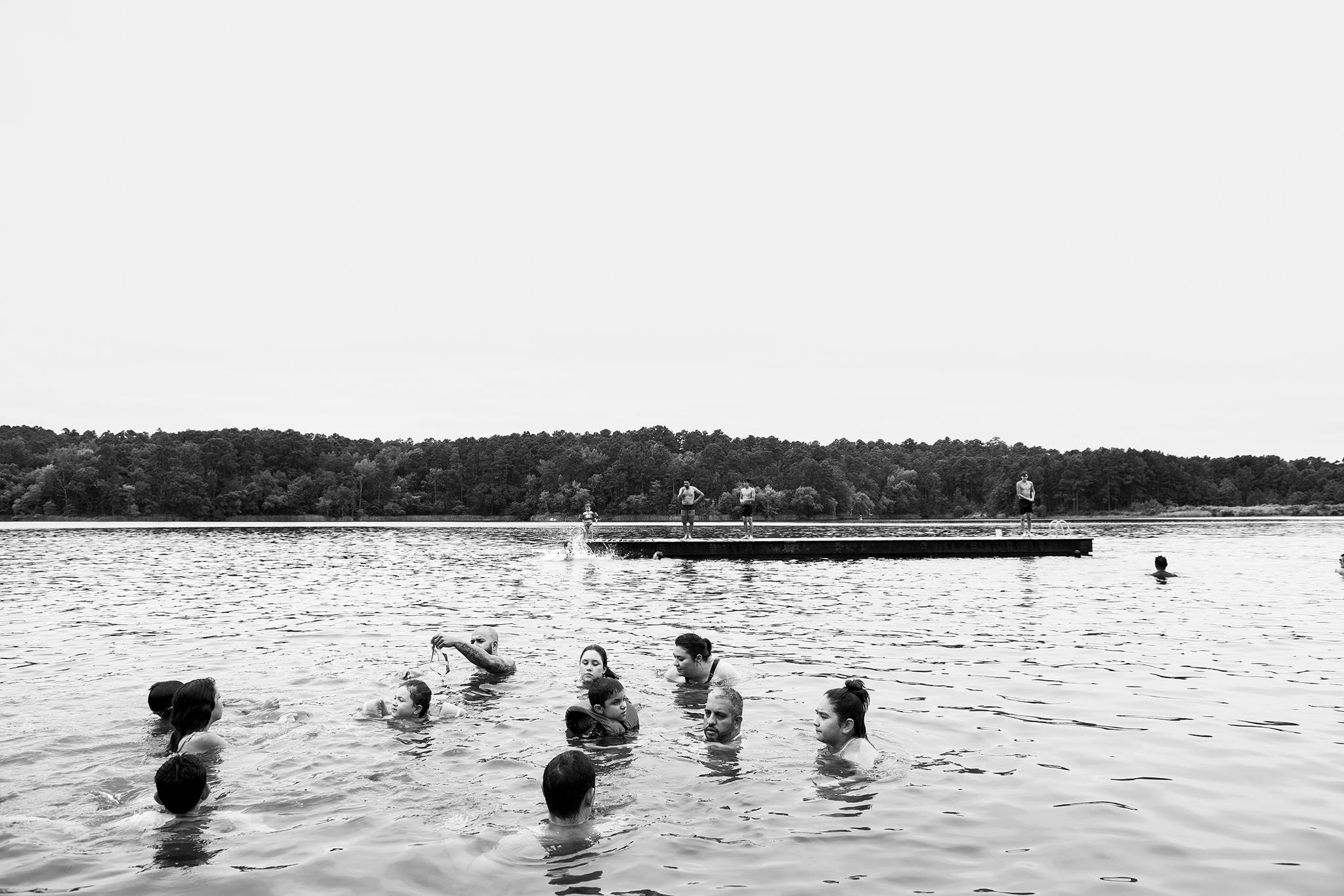 Carefree park-goers enjoying the lake at Tyler State Park pre-pandemic, in August 2019.