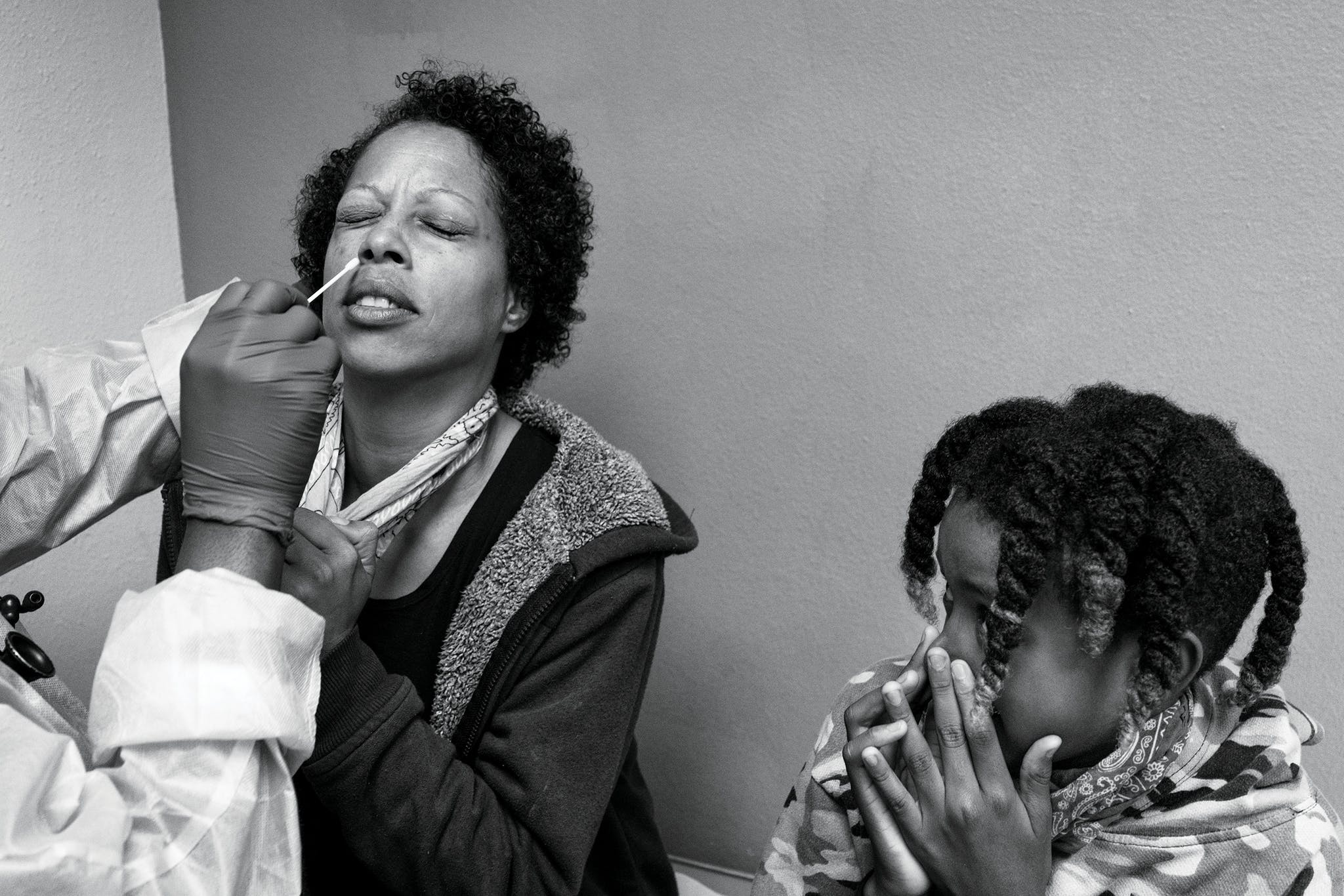 Ante Lewis, 11, watches his mother, Darline, 42, as she gets tested for COVID-19.