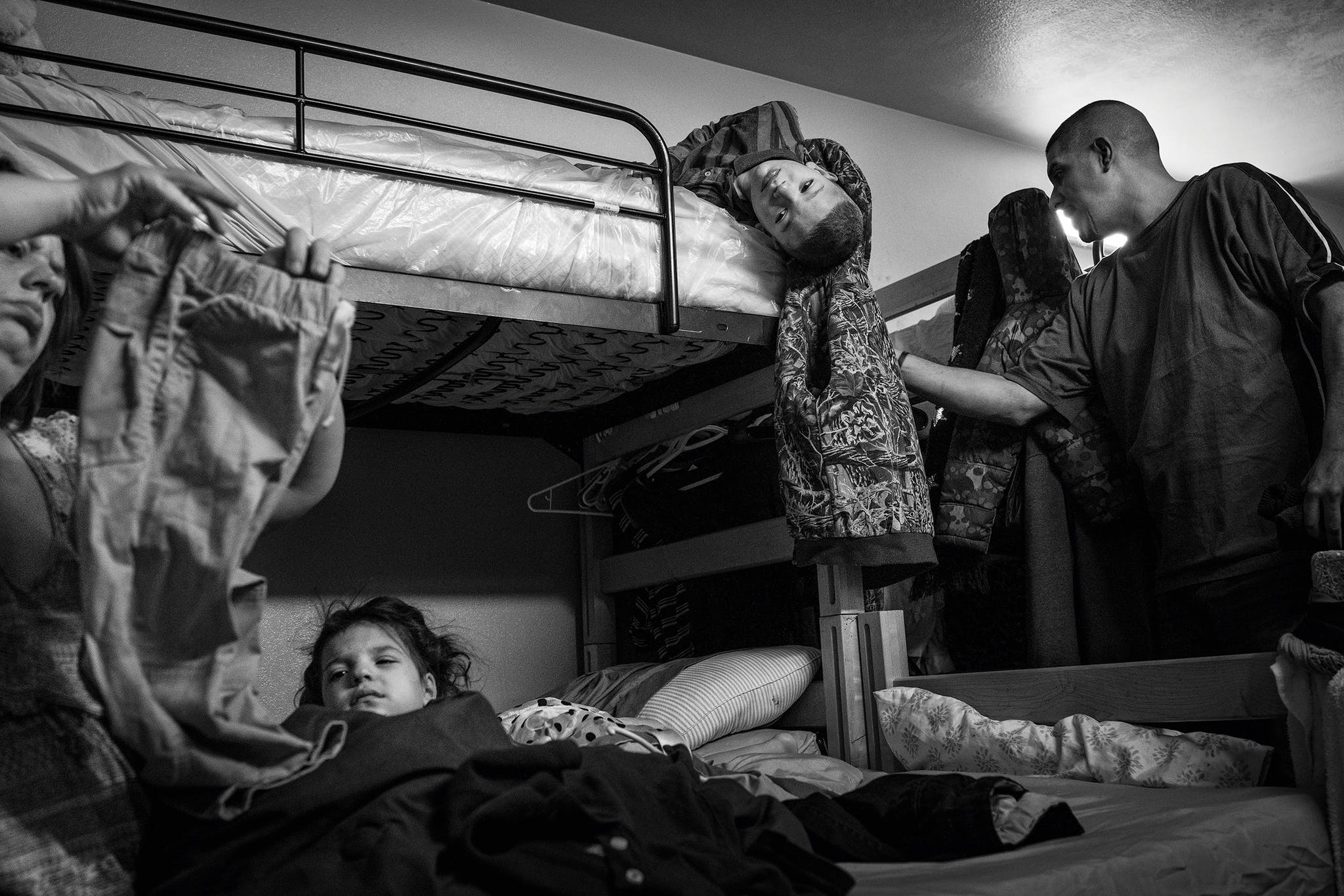 Early one morning in January 2019, Ezequiel and Jessica Pena wake up their children for school.