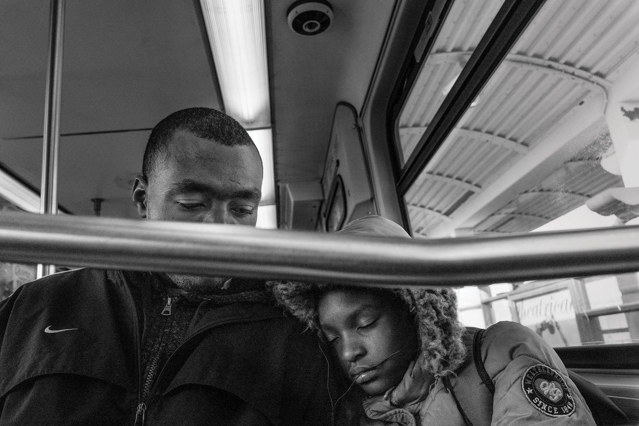 Twelve-year-old Devaiyah Buckner sleeps on her father Patrick's shoulder on the train ride back from school.