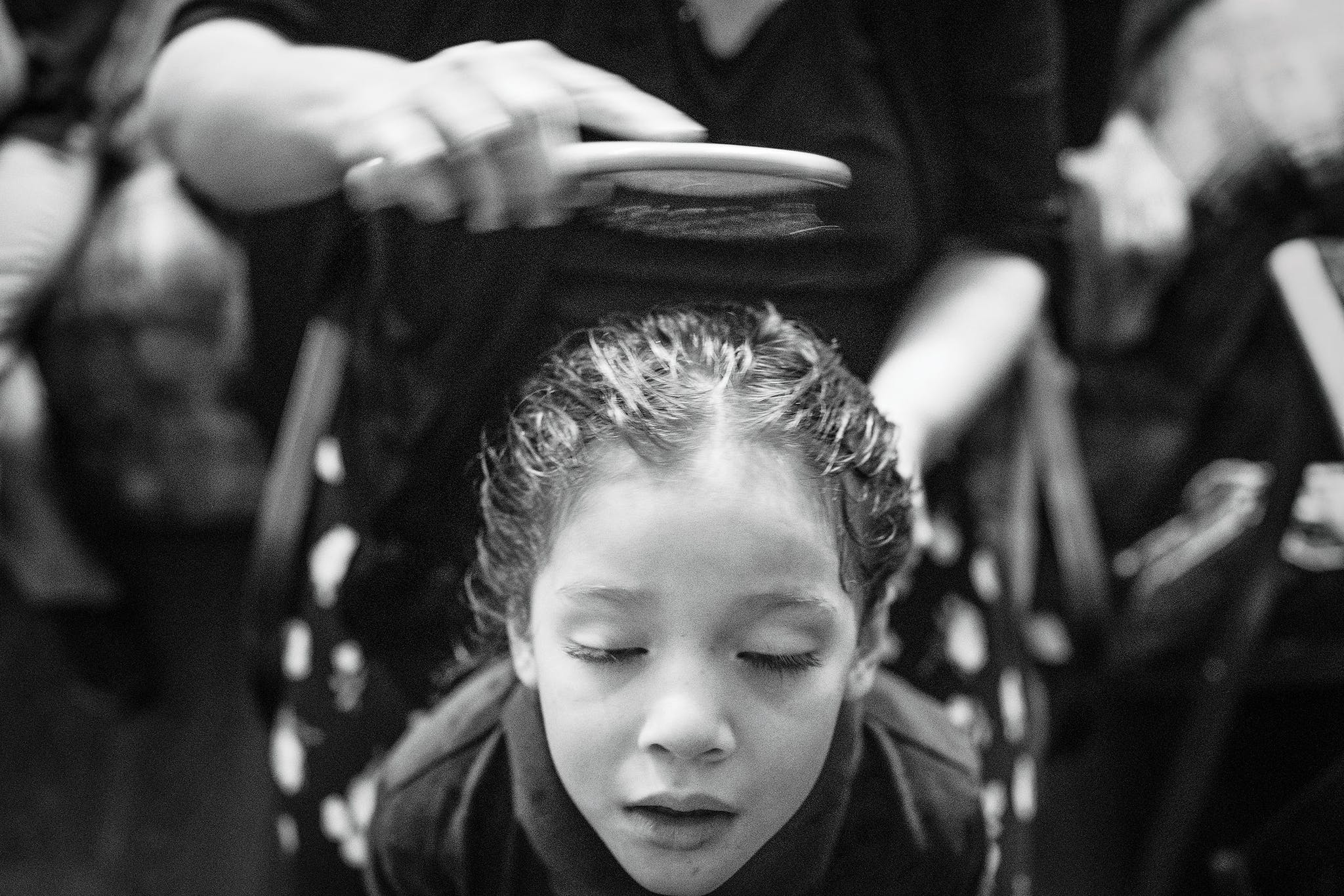 Kayla Isuala, four, has her hair brushed by her mother, Cindy, after her morning shower.