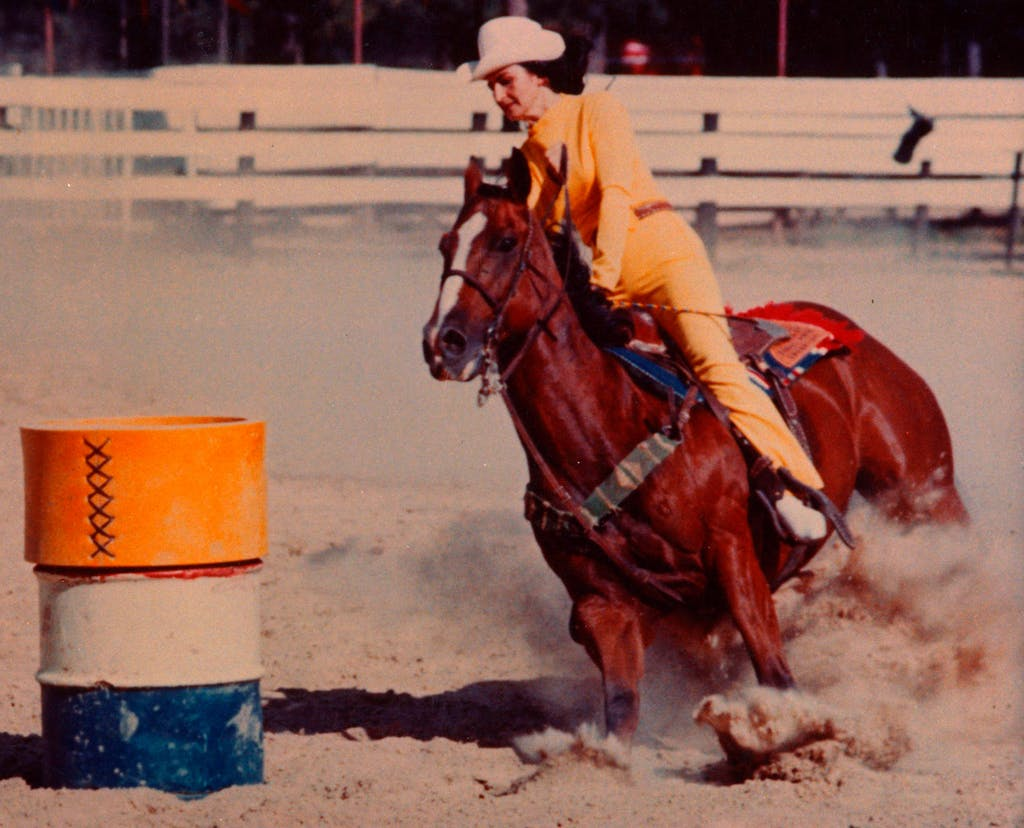Martha rides Cebe Reed in the National Finals Rodeo, circa 1969.