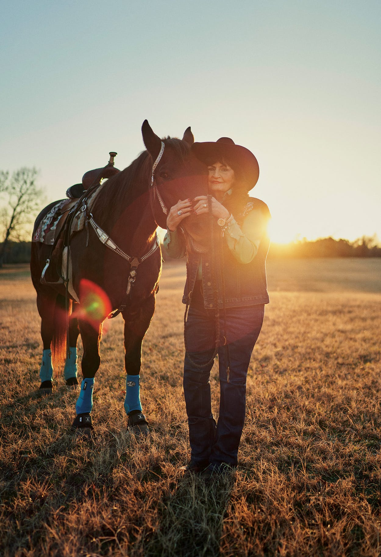 Martha Josey hugs her horse Cutter at Josey Ranch, in Marshall, on December 17, 2020.