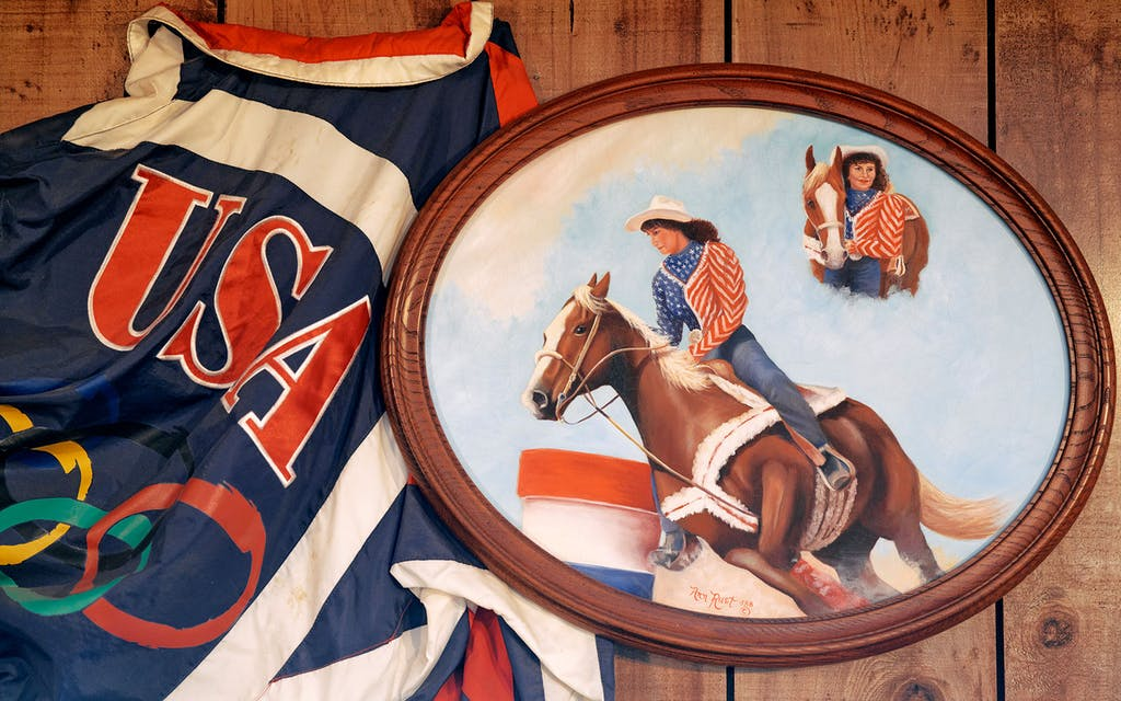 Memorabilia from the 1988 Winter Olympics in which Martha was a part of the USA barrel racing squad hangs on a wall at Josey Ranch.