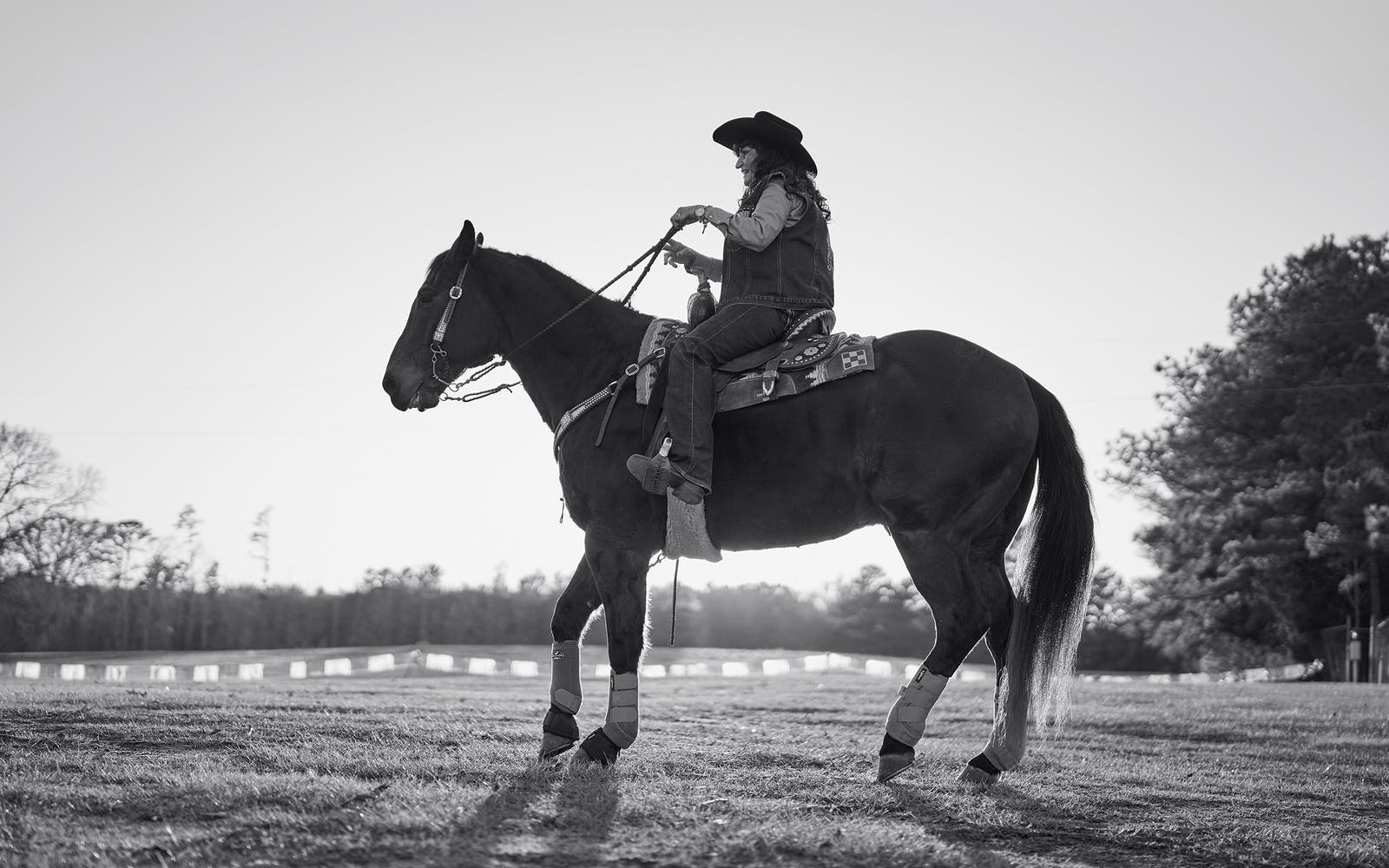 Martha rides Cutter at Josey Ranch.