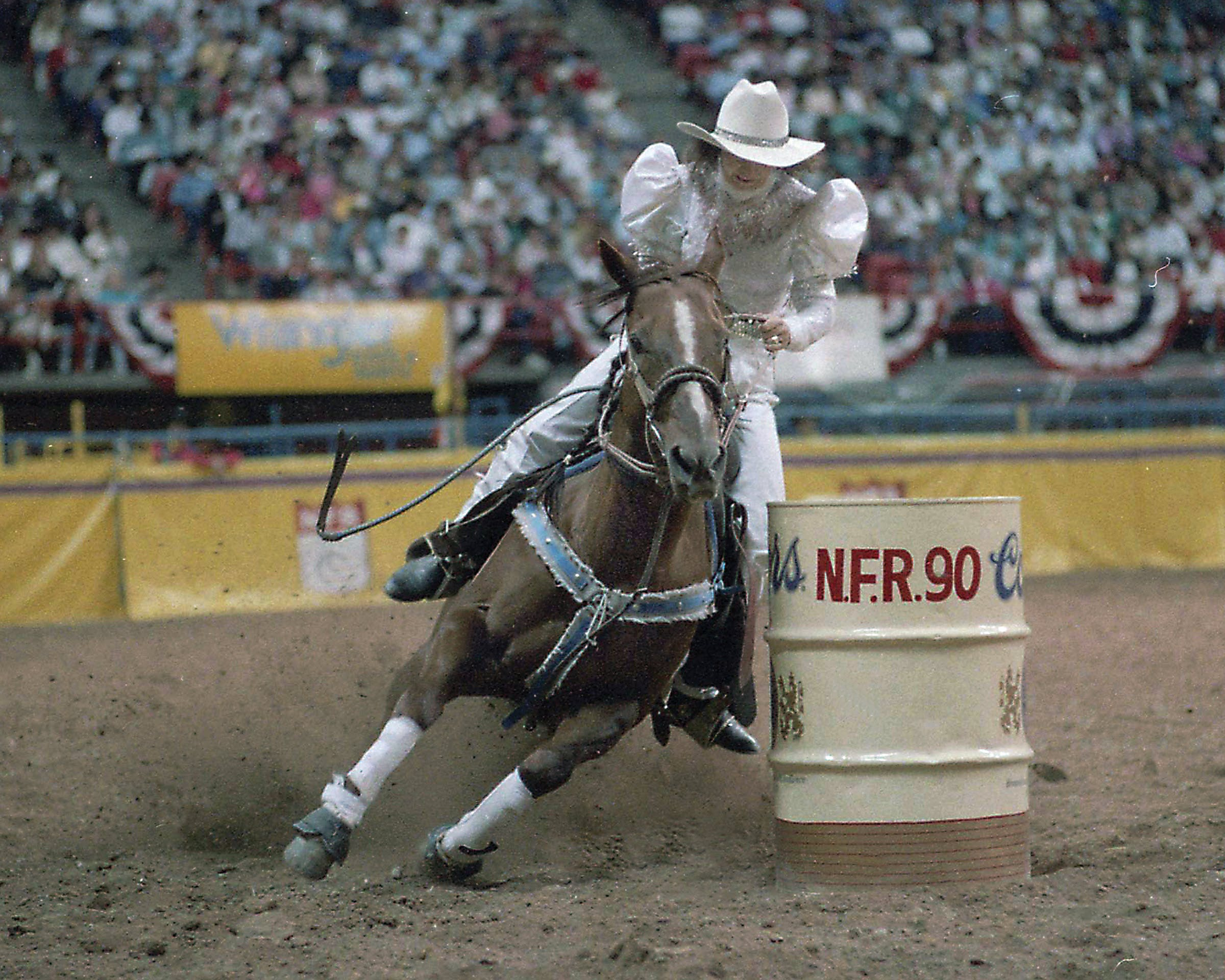 Martha competing in the outfit she had fashioned out of a wedding dress, at the 1990 National Finals Rodeo.