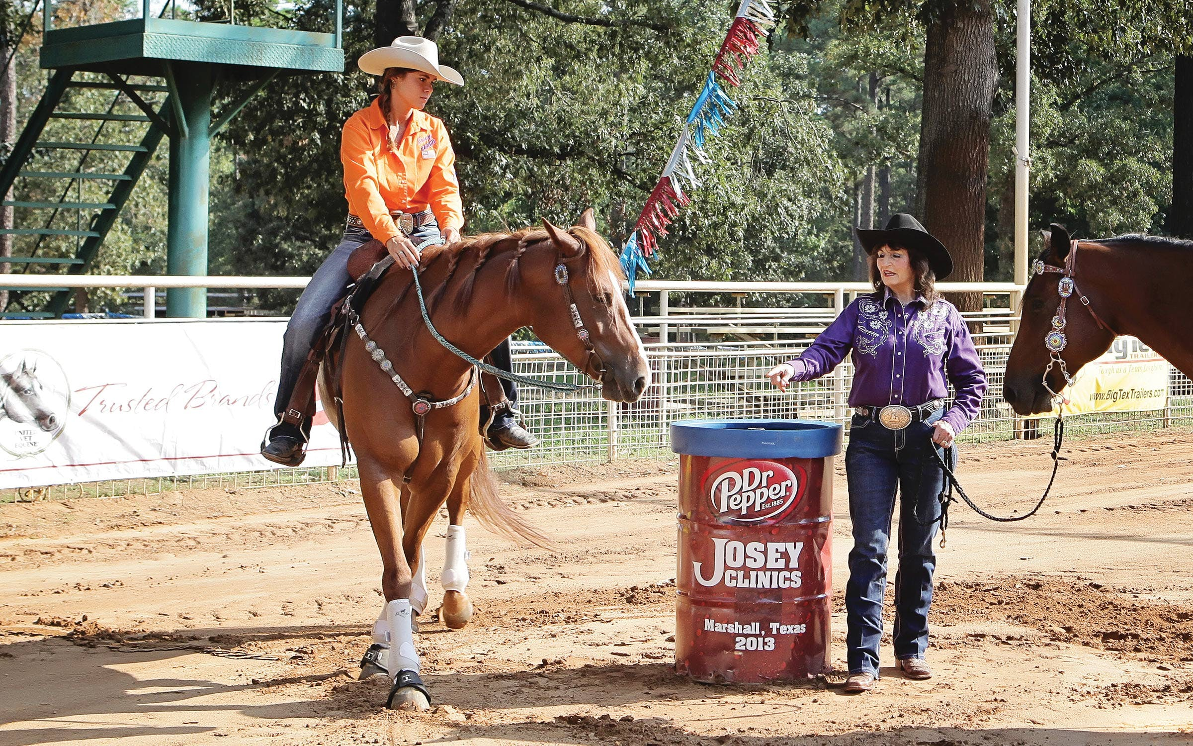Martha instructs a student at one of her clinics at Josey Ranch in 2013.