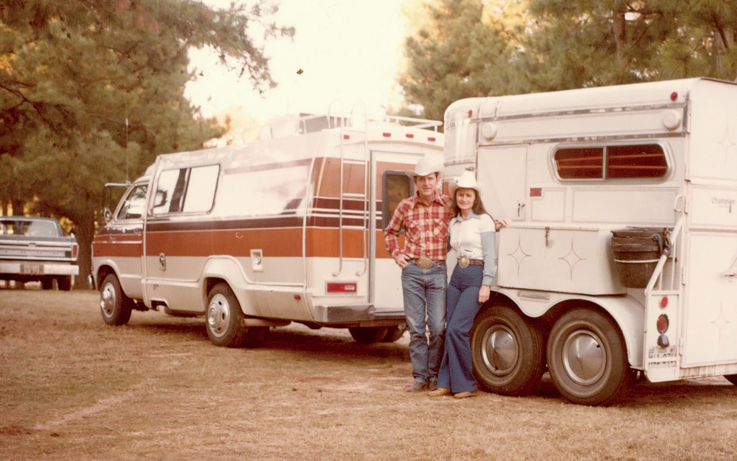 R. E. and Martha Josey in front of a horse trailer circa 1970.