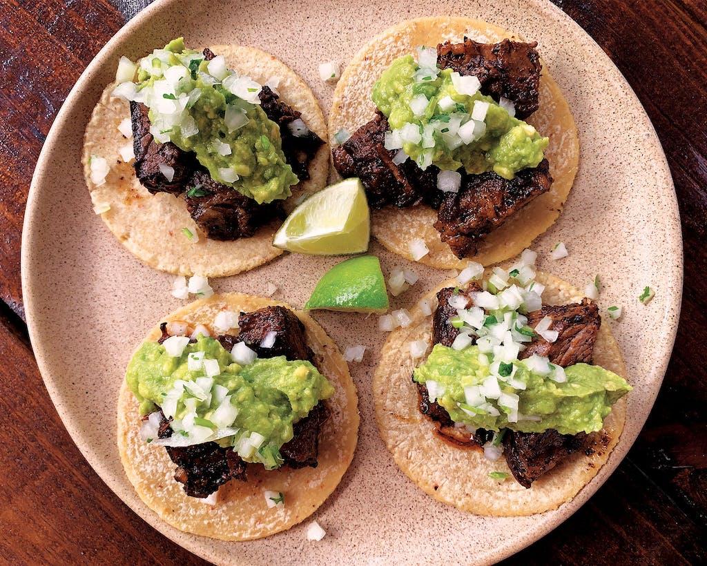 """Suerte's suadero tacos are dressed with Chef Fermín Nuñez's salsa macha recipe, which he calls """"black magic oil."""""""