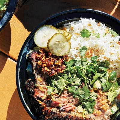 Curry Boys BBQ serves fusion bowls like oak-smoked brisket in green curry.