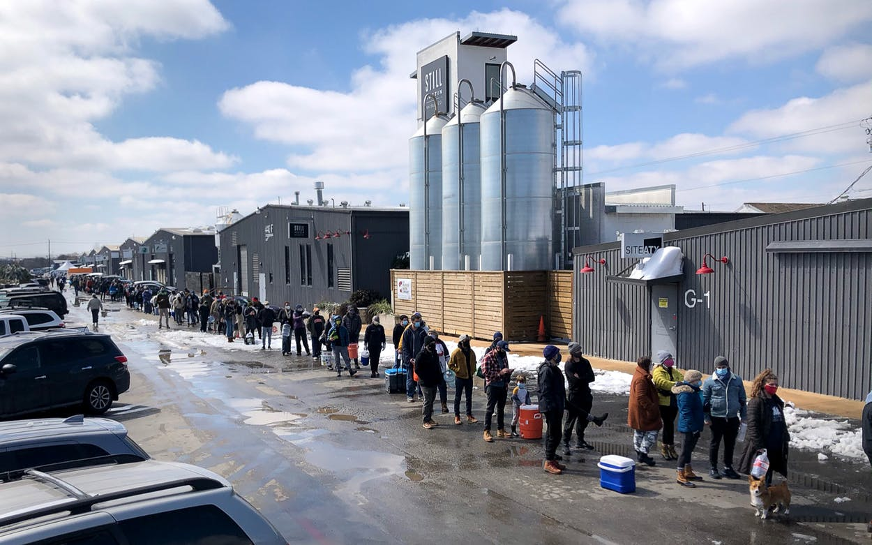 Austin residents wait to receive potable water at St Elmo Brewing on February 20, 2021.