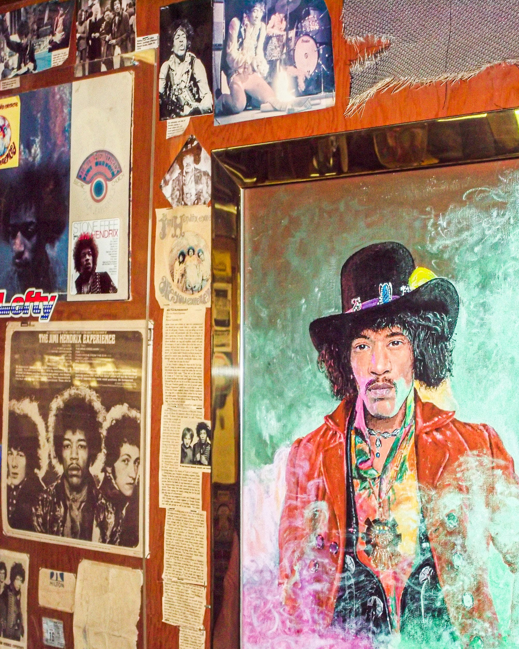A Jimi Hendrix oil painting by San Marcos artist Michael Giles is surrounded by memorabilia collected by Bobby after meeting Hendrix in 1968 after his first Dallas concert.