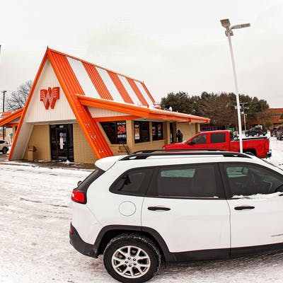 Cars wrap around a Whataburger as they line up to order food after a snow storm on February 17, 2021 in Fort Worth.