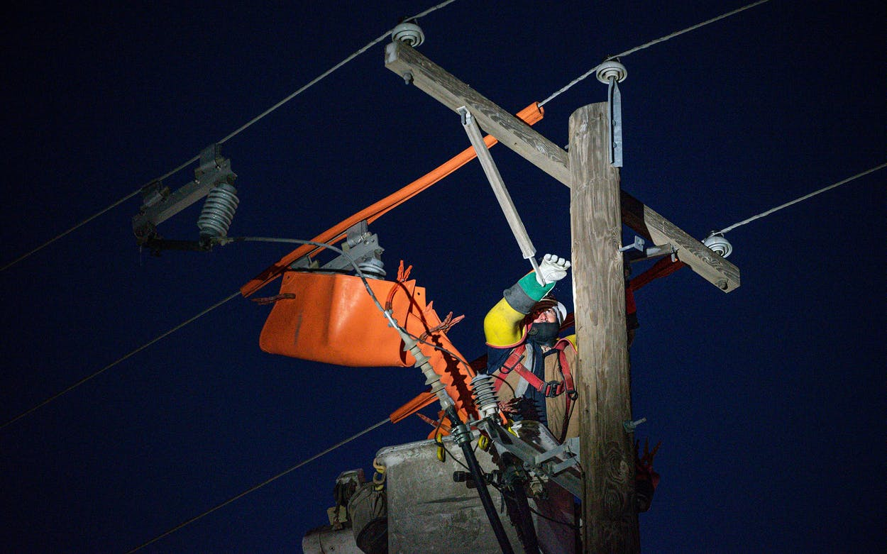 Oncor apprentice lineman Brendan Waldon repairs a utility pole that was damaged by the winter storm that passed through Texas Thursday, Feb. 18, 2021, in Odessa.