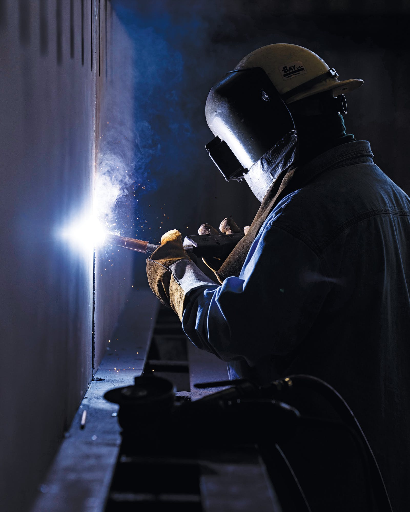 A worker welding one of the sub-blocks of the Charybdis.