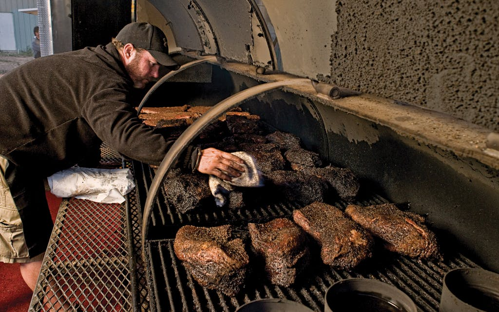John Mueller, tending his meat.