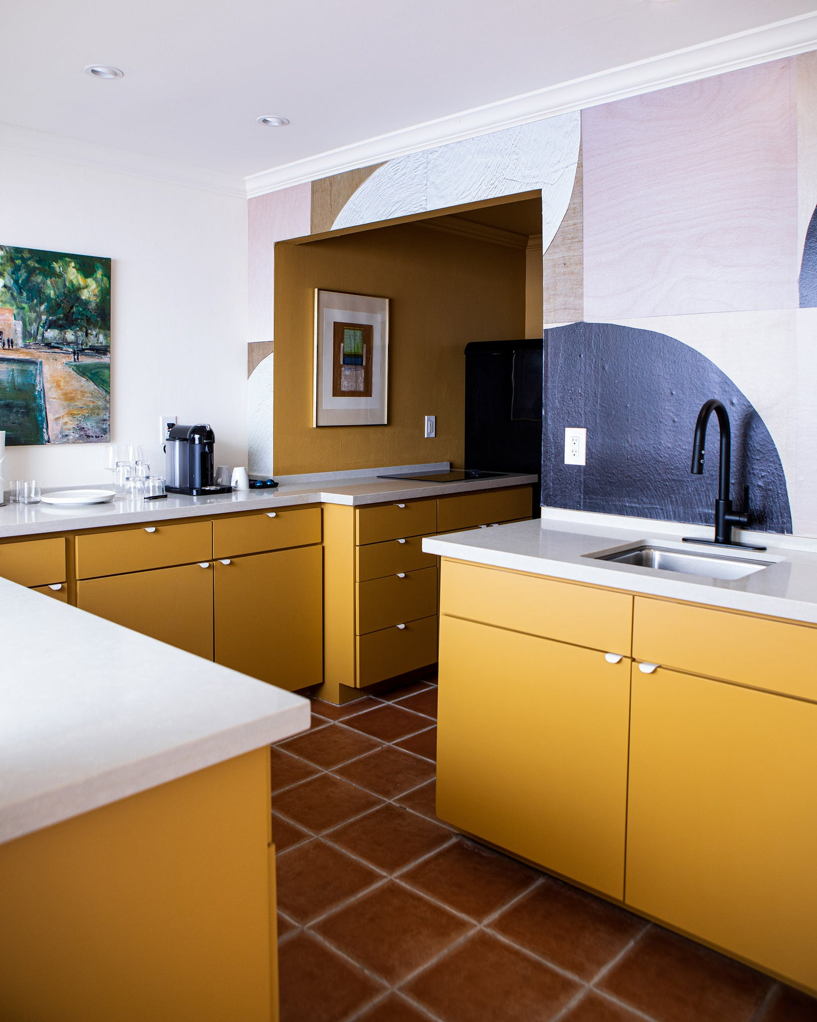 Though equipped with modern appliances, the retro kitchens have a midcentury modern vibe.