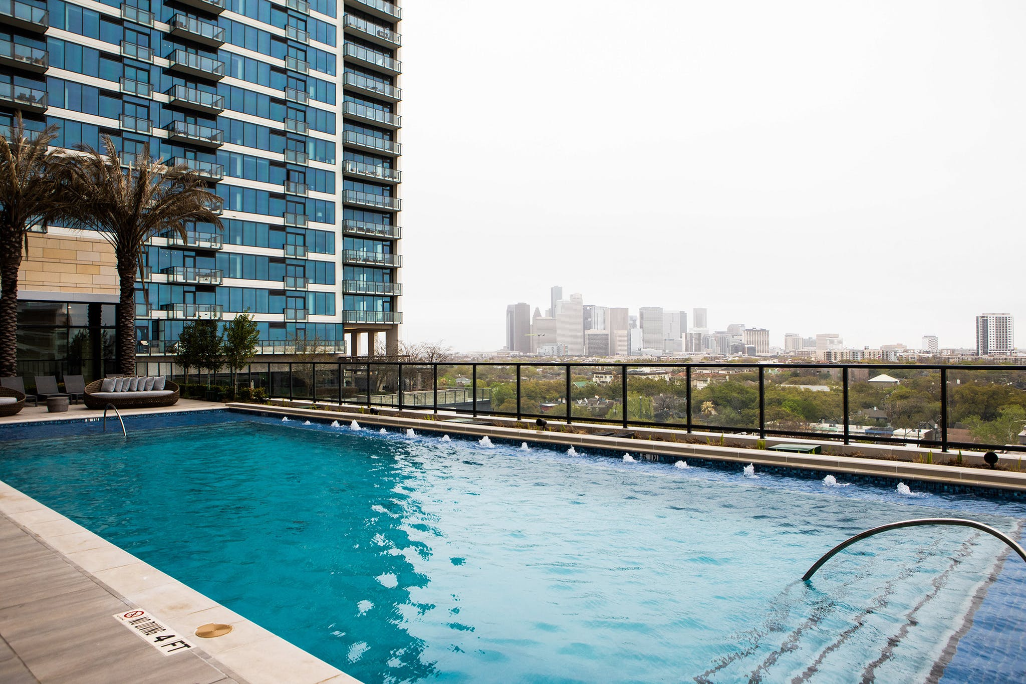 """""""You feel like you're in this little European city,"""" Dan says about the hotel, where it even sounds like you're across the pond: nearby church bells ring in crisply throughout the day. But the view of downtown Houston from the pool is unmistakeable."""