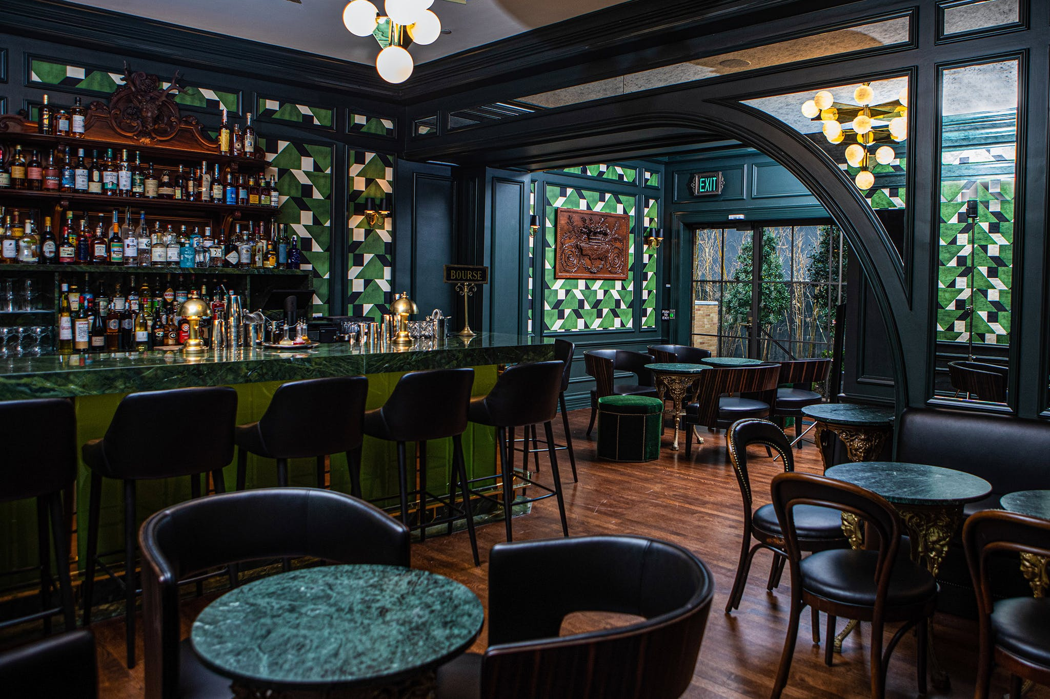 Like every material and motif introduced into the updated space, the bar's wallcovering is true to 1920s design, printed with a Russian pattern from that era.