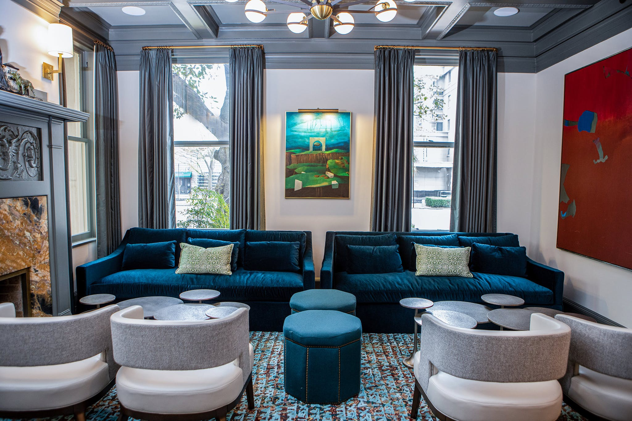 In the lounge, which was originally built as a library, a painting by Texas artist Lucas Johnson shares space with one by fellow Texan Dorothy Hood.