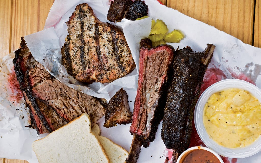 The offerings at offerings at JMuellerBBQ, which include ribs, pork chops, and brisket.