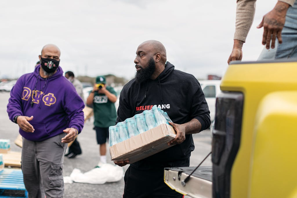 Trae handles a case of water in Houston on February 20, 2021.