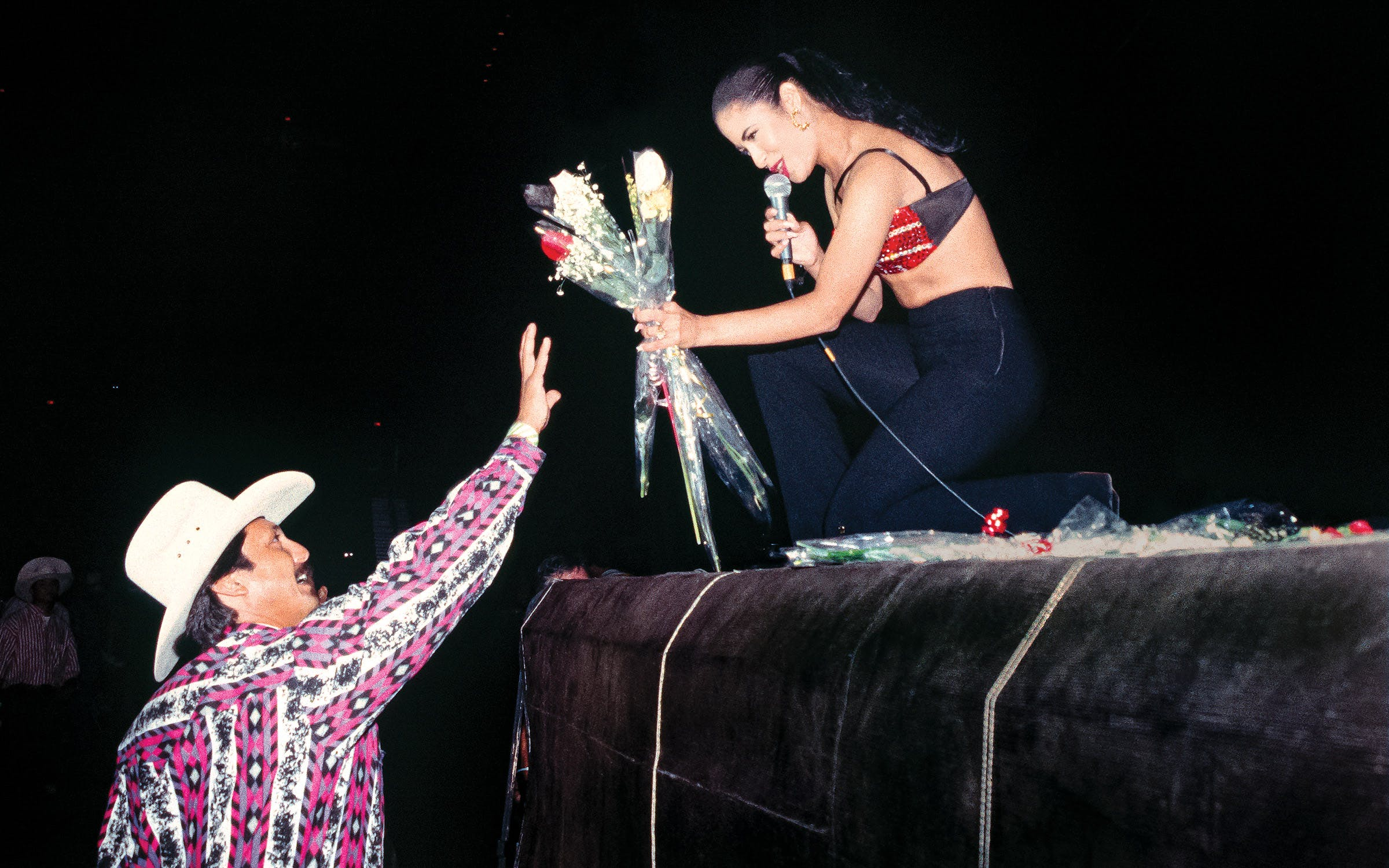 Selena accepting roses from a fan at the 1993 Tejano Music Awards in San Antonio