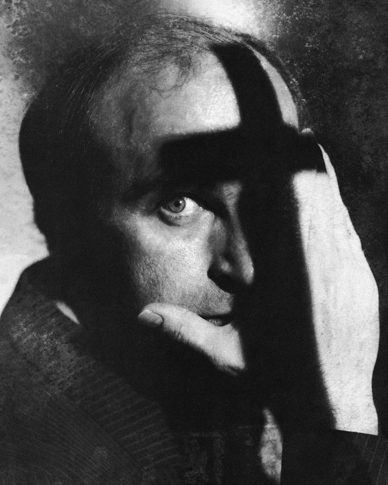 A conceptual photo illustration of a model stand-in for Reverend Walker Railey, with a shadow of a cross obscuring his face.