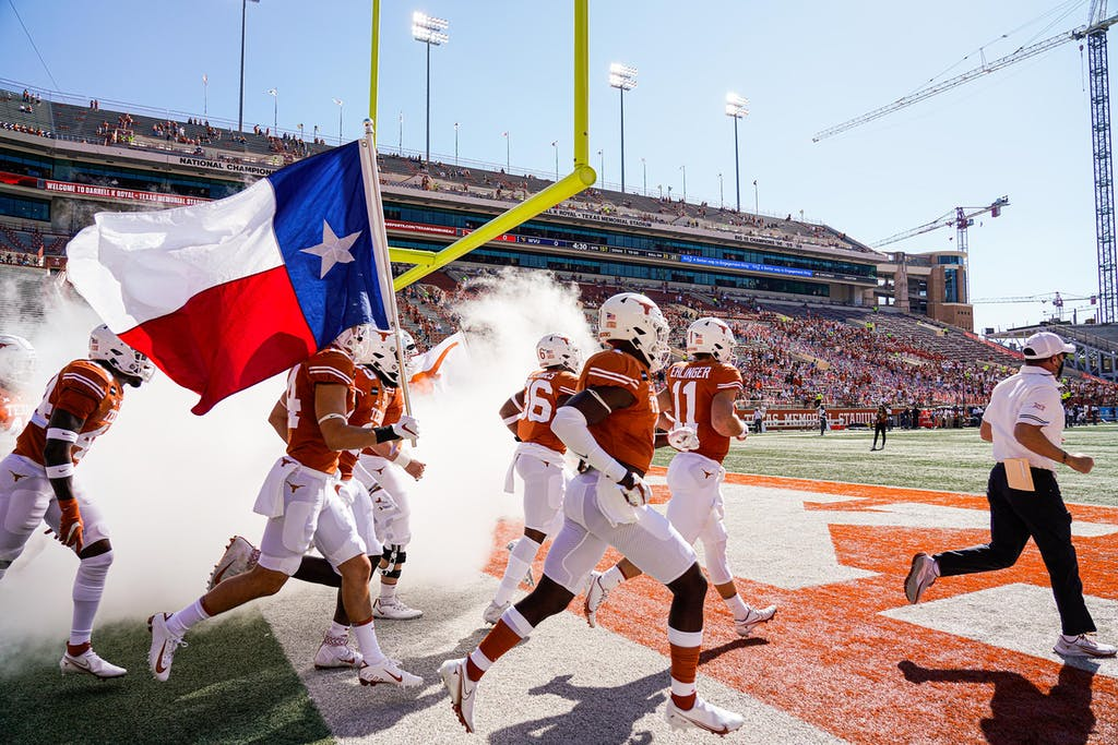 Texas head coach Tom Herman leads his team onto the field before an NCAA college football game against West Virginia in Austin, Saturday, Nov. 7, 2020.