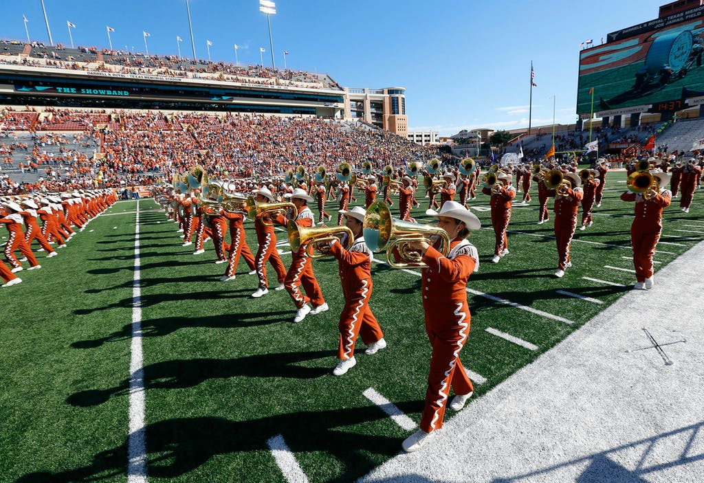 The University of Texas Longhorn Band performs before the NCAA Big 12 game between the Texas Longhorns and the West Virginia Mountaineers on November 8, 2014 at Darrell K. Royal-Texas Memorial Stadium in Austin.