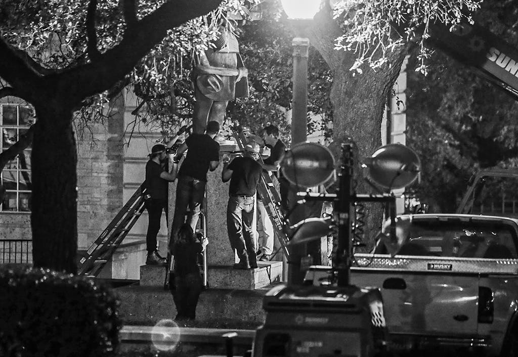 Confederate statutes including that of former Texas Governor James Hogg are removed from the University of Texas early Monday, Aug. 21, 2017, in Austin.
