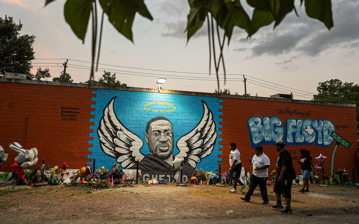 People visit a memorial and mural that honors George Floyd in Houston's Third Ward where Mr. Floyd grew up on June 8, 2020 in Houston.