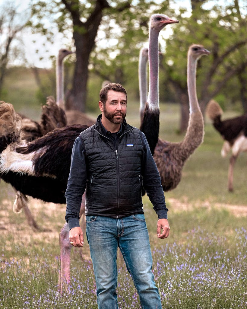 Boyd Clark with the herd at Clark Ostrich Farm in April 2021.