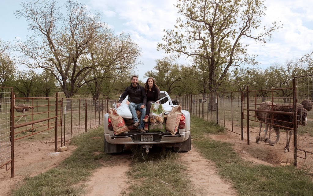 Boyd Clark and his fiancée, Brandi, make the rounds feeding the ostriches.